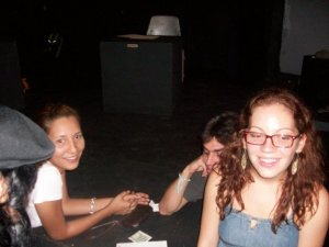Alejandra Maldonado and members of TeatRUM discuss up-coming productions in the small theater of the Chardon Building.