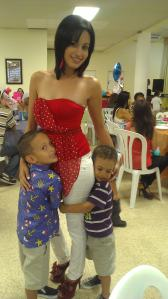 Keysis, a few months ago, with her two sons, Luis Yandel, 6, and Luis Yavell, 4, during her first son's Accomplishment Day Activity.