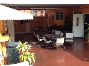 This is the eating area/dining room at Casa Del Peregrino.  The open door to the left is the entrance to the bathing area.