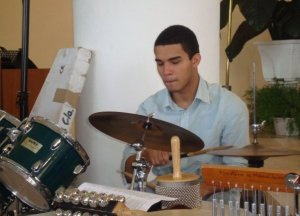Ernesto Julio playing the drums.