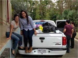 Above is Laura in the pickup truck moving the bags of clothes for the poor people of Haiti and Dominican Republic. Picture retrieved via email from Laura.