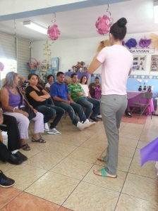 Camille giving a workshop of how to make reciclyng materials, at the Aging Center in Mamey, Aguada.