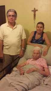 "Vicente Rosario and Luisa Rosario taking care of their bed-bound mother Gloria Rivera at her house. Gloria is 97 years old and her children planned the way they would take care of her when she reached this age and couldn't do things by herself. Vicente said: ""My sister and me never got married, we didn't have any children, so we've dedicated our lives to taking care of our mother since she's the only family we have left."""