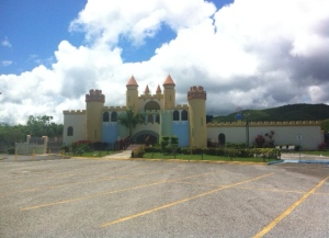 "The ""Children's Castle"" in front of the sports complex of Guayanilla on a Sunday afternoon. For six years The children's Castle was a ""fun zone"" for children since it has thrill rides. Due to the economic increase the amount children that visited the castle decreased and sometimes it is closed for weeks."