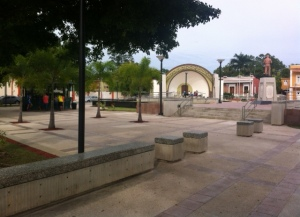 Guayanilla's town plaza  on a Sunday afternoon with its new snack shop and renovated stage. Since the plaza had been a monumental and historical asset to the town of Guayanilla, it was renovated in 2012. However the plaza mostly remains empty because there are a lot of homeless begging for money.
