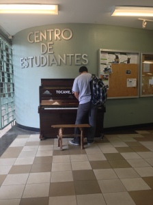 "Located in the third level of the students center is a piano that, in the picture, is being used by one student. The piano is part of an artistic project  by Luke Jerram called ""Tócame soy tuyo"". The project seeks to invite others experience art in  different ways and places ."