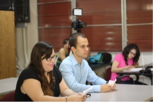 Interviewers Natali Rivera and Bryan Acosta listening to the panelists.