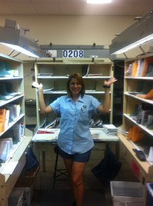 Mayra in her post office job in Tampa, Fl. Showing strength and letting people know she is doing fine. She is always with a smile in her face.
