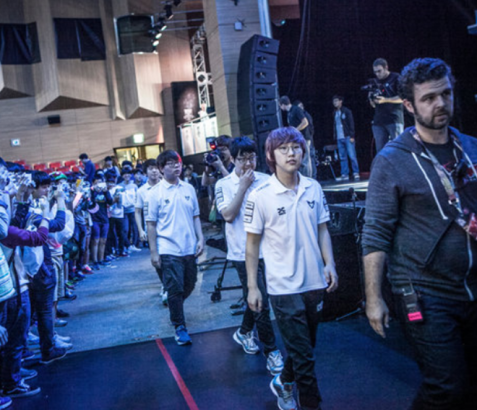 Samsung Galaxy White, a Korean professional League of Legends team walk towards the big stage. The team sponsored by Samsung won the 2014 World Championship. They followed the steps of 2013 Champions SKT 1, and reigned victorious in their own country. Image courtesy of Jean Chung for The New York Times