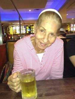 "While in a restaurant with the family, Aida Toro tries to steal Joaquin's beer until her daughter Mayra caught her. Aida use to enjoy the occasional drink before being diagnosed with Alzheimers. ""but why not?""."
