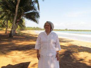 Anita posing for a photographer at a beach in Rio Grande.
