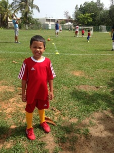 A young kid at soccer practice, shortly after completing a drill. Whether it is by practicing a sport, going to the gym, running, or simply walking to places close to you instead of using the car try to keep yourself active. An active person is a healthy person.
