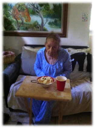 "Aida Toro eating breakfast in her room while enjoying some television. Before moving in with her daughters family Aida use to eat ""Frosted Flakes"" with cut up banana every morning. ""What are you doing? Did you eat already? Want some?"""