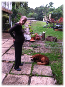 "Aida goes for a little walk outside while having a 'conversation' with Zeus the house dog. Throughout her life she has always been an animal lover. ""Zeus are you okay?, go eat; want me to bring you food?""."