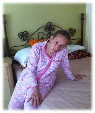 "After almost 20 minutes she sits in her bed watching television wearing her pink pajamas. Before becoming an Alzheimer's patient she use to have her daily clothes ready for when she would change; use to be very organized. ""Tell you're mother to come here, I still cant find my yellow pajamas""."