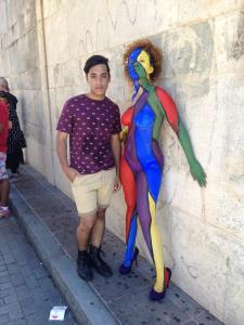 "As a member of the LGBTQ community, Alex participates in several activities involving the defense of the gay rights. A few months ago, he was able to be part of the gay rights parade that took place in San Juan. ""I, as an individual who is gay, should help break down the stigmas, stereotypes and negative concepts towards the LGBTQ community."""