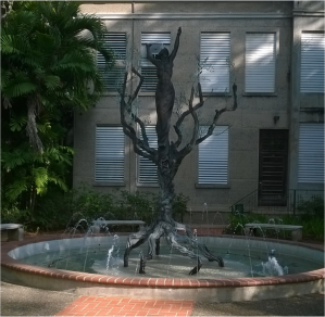 "The bronze sculpture El Árbol de la Vida (""The Tree of Life ""), by Puerto Rican artist José Ángel Buscaglia Guillermety is located on the side of the José de Diego building. The work, which has 15 feet of height was designed in 1967, transferred from Spain, and placed facing what was once the Post street. Years later is forgotten in the Physical Plant Welding Workshop, where the professor Lydia González Quevedo and some of her students found it in 2002; its restoration is requested and in 2004 reinstalls the place it occupies today."