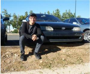 "Hector Vargas,  second year student of Business Administration and his Toyota Corolla. He needed a car and his parents bought him this Corolla for him to move. ""This is the second Corolla in our group, that's way 2.0 is his name."""