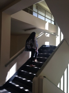 "Pregnant student taking the stairs to get to her class. When the pregnant women took the stairs to get to her classes was a challenge and could be a danger especially because she can not saw her feet. ""If walking was difficult taking the stairs is more exhausting"""