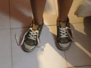 "This are the feet of a pregnant student with her shoe cords loose . For this pregnant women was hard to tie up her shoes and it became a challenge in the campus to find someone that could helped her. ""It has being challenging for me to tie up my shoes and I even had to tell strangers to please help."""