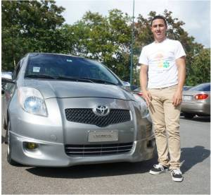 "Johny Rivera, a 3er year Accounting student with his Yaris. Like many student, he decided to buy a car for him in his second year. ""I love my car and he is always clean and ready to go out."""