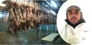 With his lab coat, gloves and boots, Enrique works inspecting the cows' carcasses in the freezer after the slaughter.