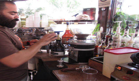 Hernán Rodríguez getting ready to prepare an espresso. He explained that there are three methods for espresso extraction. These are the French press, the Chemex, and Siphon.