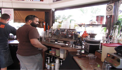 """Hernán Rodríguez, a barista, getting ready to prepare a cup of coffee. He has been an employee since the beginning of Friend's Café. """"I've been there since the owner pitched us the idea of opening a coffee shop."""""""