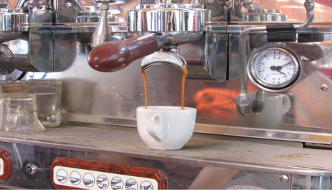 An espresso machine using the French Press method to make an espresso. The barista used a two spout gaggia portafilter which contains 14 to 18 grams of coffee. A one spout gaggia portafilter only contains seven to nine grams of coffee.