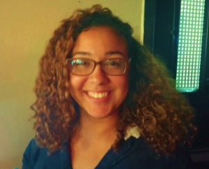 "Perla Valencia, 23, from Arecibo, Puerto Rico shows her striking curls with a smile while sitting at La Cueva de Tarzán. Perla said that when she was in elementary school they used to call her ""mapo"" because of her curly hair. Today she takes time in making it look good by washing her curls every two days and using different hair masks to keep the same texture, ""I love my hair when it's curly because it just looks great."""