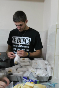 Kenneth Raices, 19, helping make and pack the food in the church's kitchen that Saturday morning. After hearing what the group had planned and what their mission was we decided to join on the work and help make a difference. We wanted to have the experience of helping a community in need.