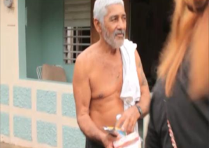 "This man in front of his  house, with his food and beverage that we gave him. He actually put his shirt on and kept going with us to give to the other homeless or poor people across all ""el pueblo"" in Camuy. ""This place needed the help from youngster's like you guys, you motivated me to motivate and help others""."