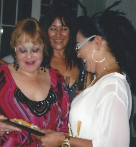 Myrna Padró receiving the Criminal Prosecution Association award from her partners in a surprise retiring party.  Chary Padró, is Myrna's sister in the back, happy to see her receiving her award from her friend.