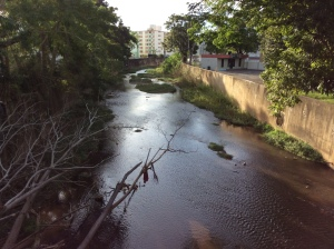 The Yagüez River near the University of Puerto Rico at Mayagüez on a Sunday afternoon. Due to the high industrialization in the city, water sources like the Yagüez River can be threatening to health. People have to be careful when drinking tap water, as it can carry diseases.
