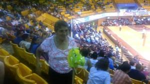 """Carmen dancing """"Caballito de palo"""" at Palacio de Recreación y Deportes de Mayagüez during a timeout at a volleyball game."""