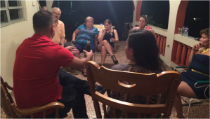 "Carlos Juan González,62; Solange Vázquez,59; Marylin Serrano,28; Carmen Luisa Vázquez,58; Irma Idalia Vázquez,57; Frances Sofía Cosme,14; and Felix Gonzalez,34; enjoying the night sharing after dinner. Many of them are from remote towns and  is a family tradition that after dinner everyone gathers to discuss their lives, the passage of time and how things change year after year and of course you can not miss the stories of previous years. ""I like to spend time as well, all together sharing our memories and flashbacks,"" said Solange Vázquez."